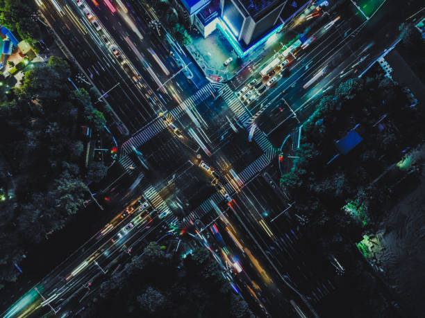 Top View of City Street Crossing at Night stock photo