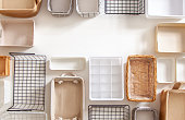 istock Top view of closet organization boxes and steel wire baskets in different shapes 1286859479