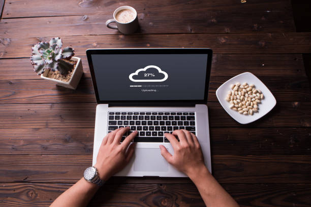 Top view of Cloud upload processing data on laptop with internet stock photo