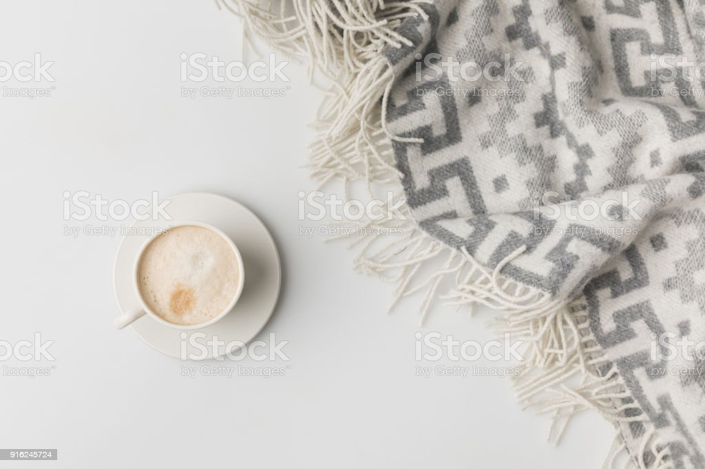 top view of coffe cup and blanket isolated on white stock photo