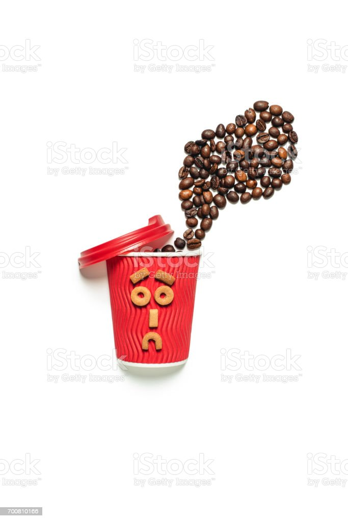 top view of coffee beans with plastic cup and cookies lay out in form of face stock photo