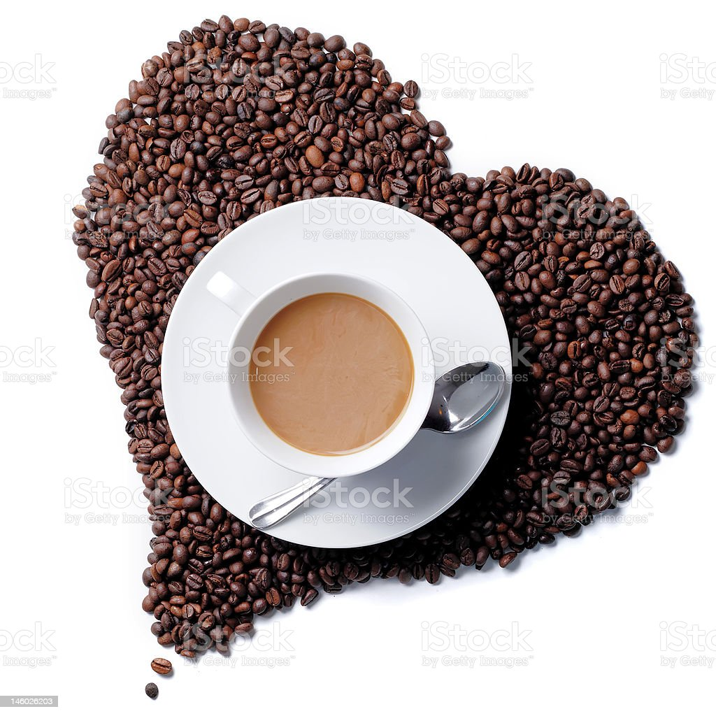 Top view of coffee cup with heart shaped beans royalty-free stock photo