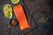 istock Top view of cold smoked trout fillet with sea salt, thume and lemon slices 1208520538