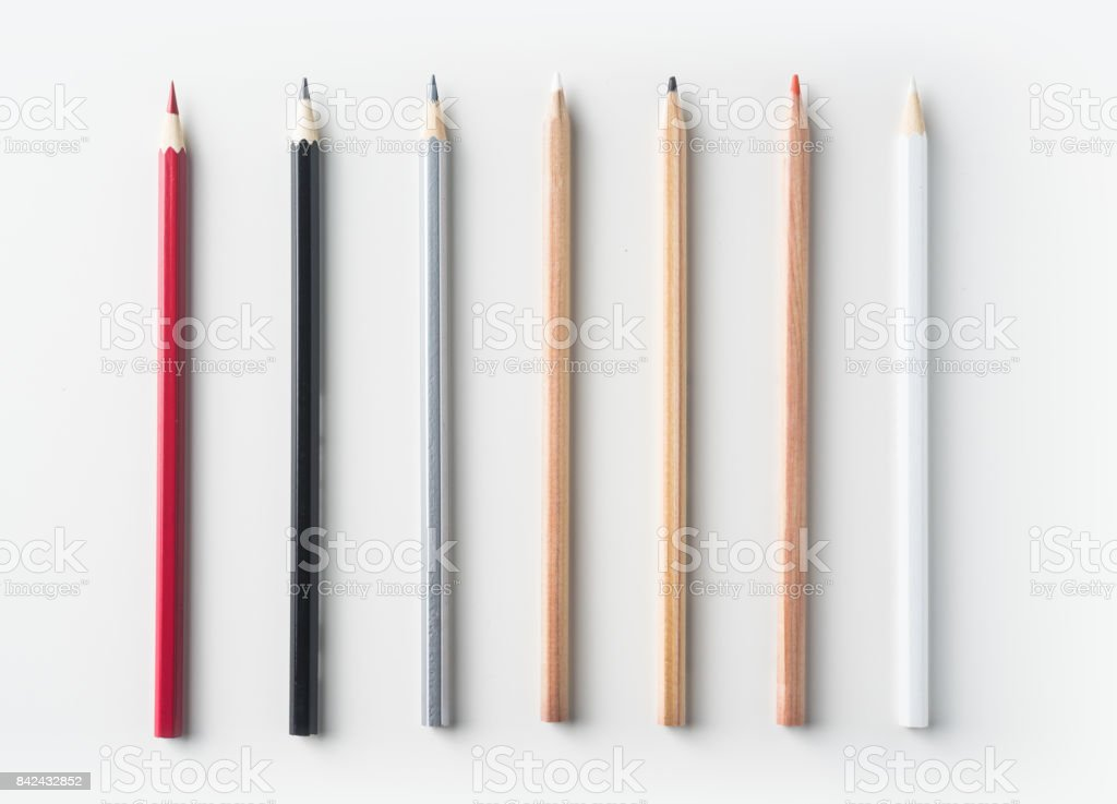 Top view of collection of pens on white background desk stock photo