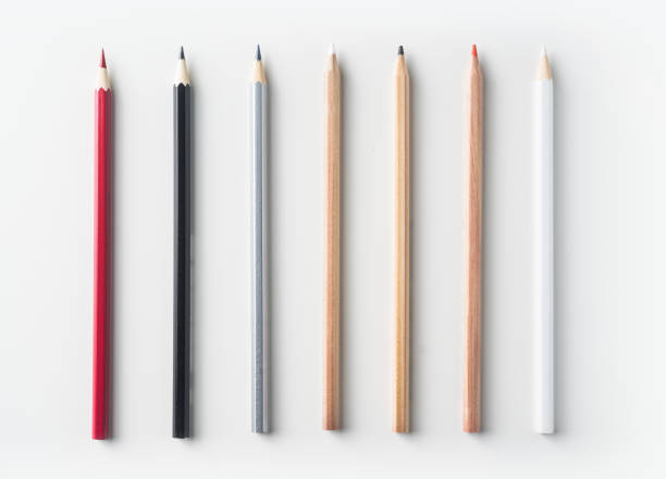 top view of collection of pens on white background desk - pencil stock photos and pictures