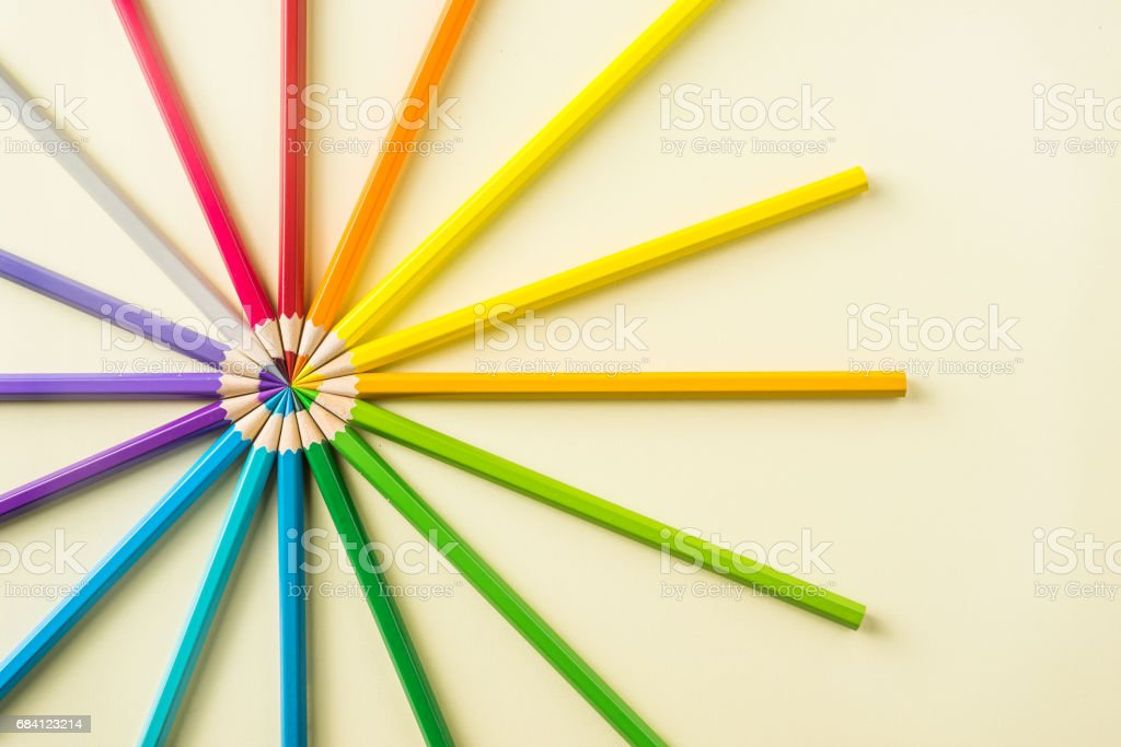 Top view of color pencil circle on yellow paper background zbiór zdjęć royalty-free