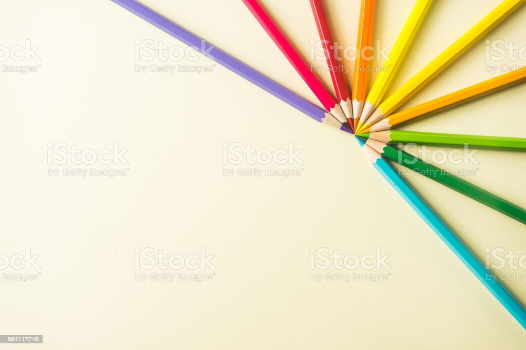 Top view of color pencil half circle on yellow paper background foto stock royalty-free