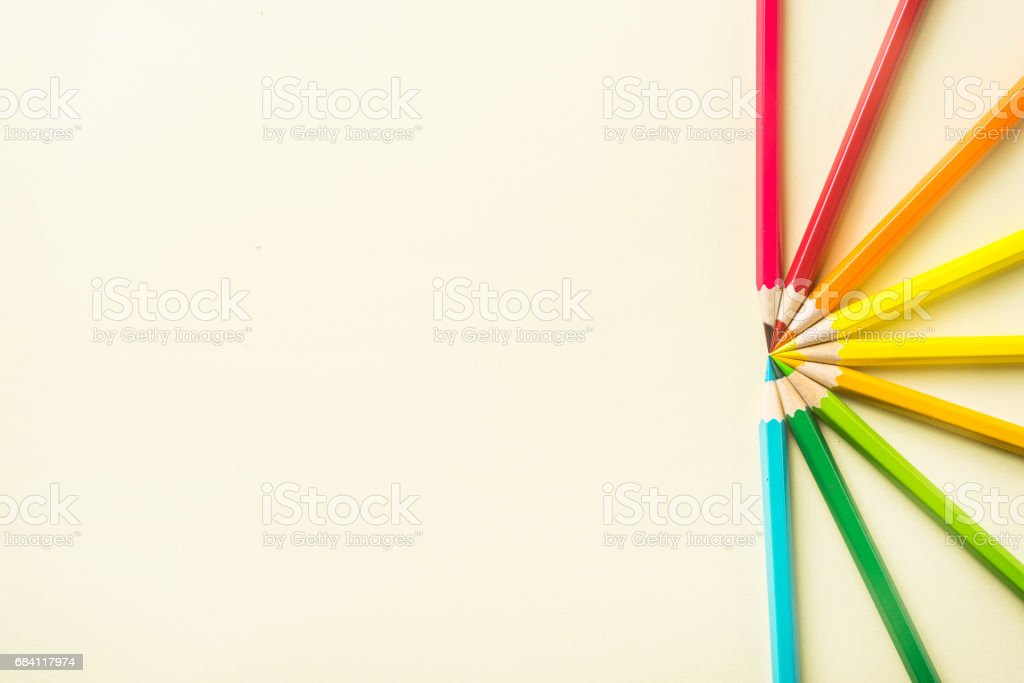 Top view of color pencil half circle on yellow paper background zbiór zdjęć royalty-free