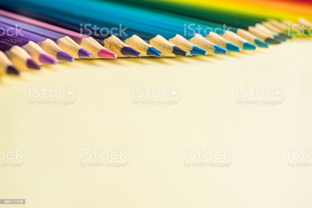 Top view of color pencil wave on yellow paper background foto stock royalty-free