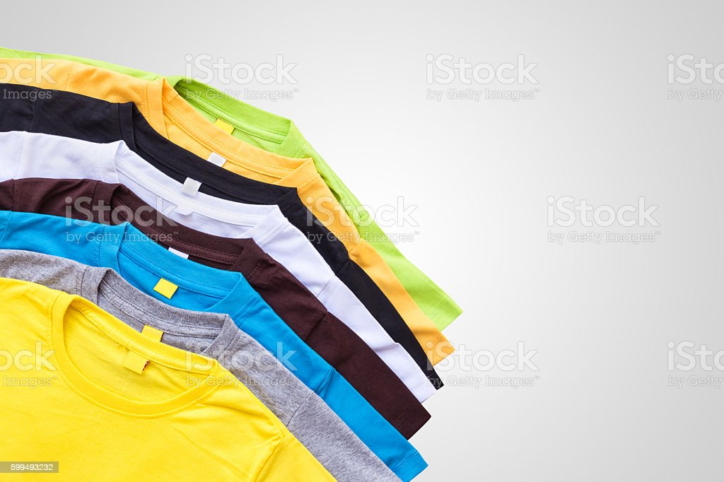 Top view of color T-Shirt isolated on grey stock photo