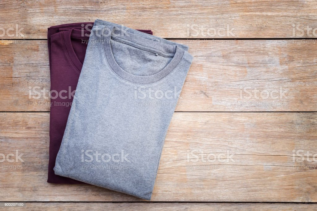 Top view of color T-Shirt on grey wood plank stock photo