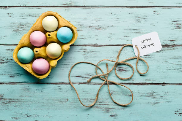 Top view of colored Easter eggs of sugar on delicate wooden background - foto stock