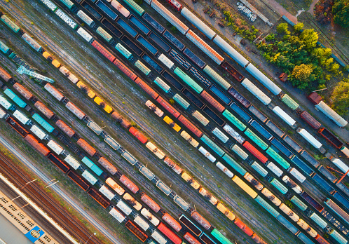 istock Top view of colorful cargo trains. Aerial view from flying drone of colorful freight trains on the railway station. Wagons with goods on railroad. Heavy industry. Industrial conceptual scene 876767464