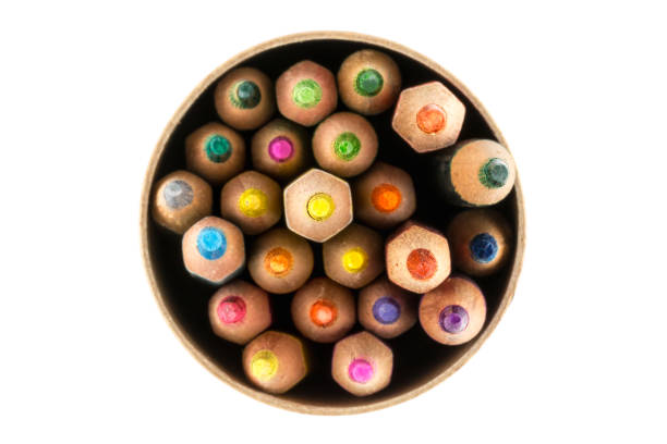 top view of colorful wood pencils in a circle box - coloured pencil stock photos and pictures