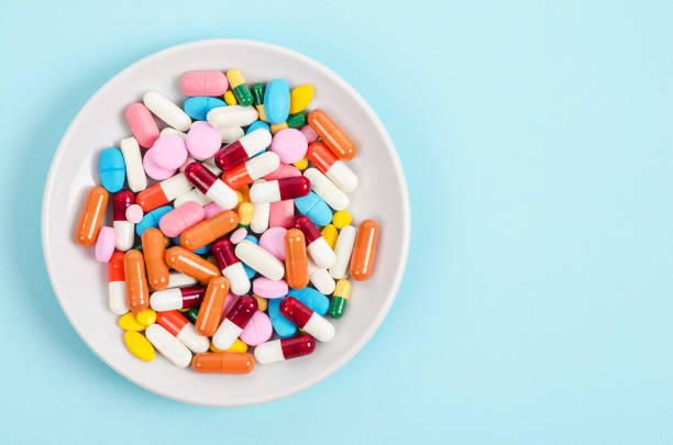 A top view of colourful medicine pills and capsules stock photo