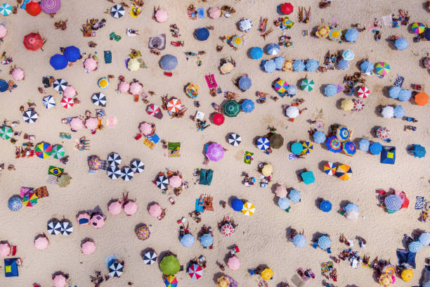Top view of colourful umbrellas and people relaxing at the beach on a picture id1097904640?b=1&k=6&m=1097904640&s=612x612&w=0&h=te ccqdp0eiur4cpy1agbcsybbxftbtbqedtacjn5vk=