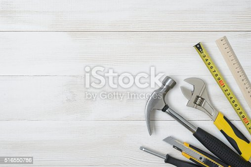 istock Top view of construction instruments and tools on wooden DIY 516550786