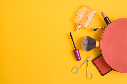 Top view of cosmetic bag with makeup items