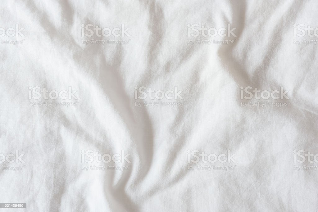 Top view of creased / wrinkles on unmade bed stock photo
