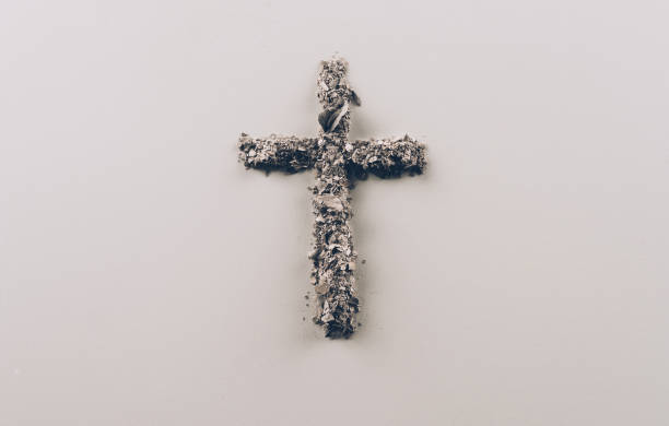 top view of cross shape from ash on white surface - ash cross stock photos and pictures