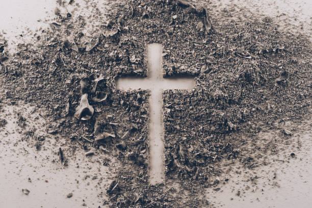 top view of cross shape from ash on white table - ash cross stock photos and pictures