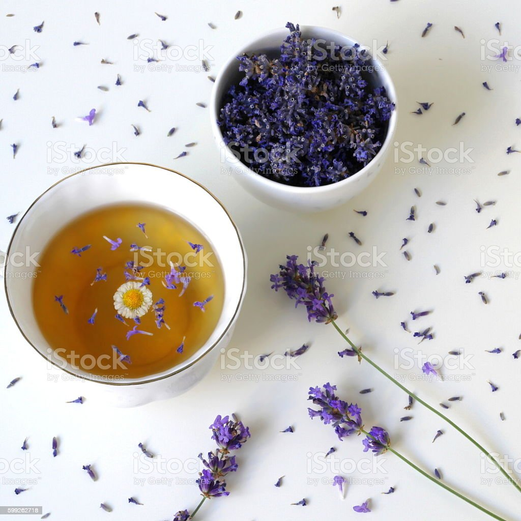 Top view of cup herbal tea and dried lavender flowers. stock photo