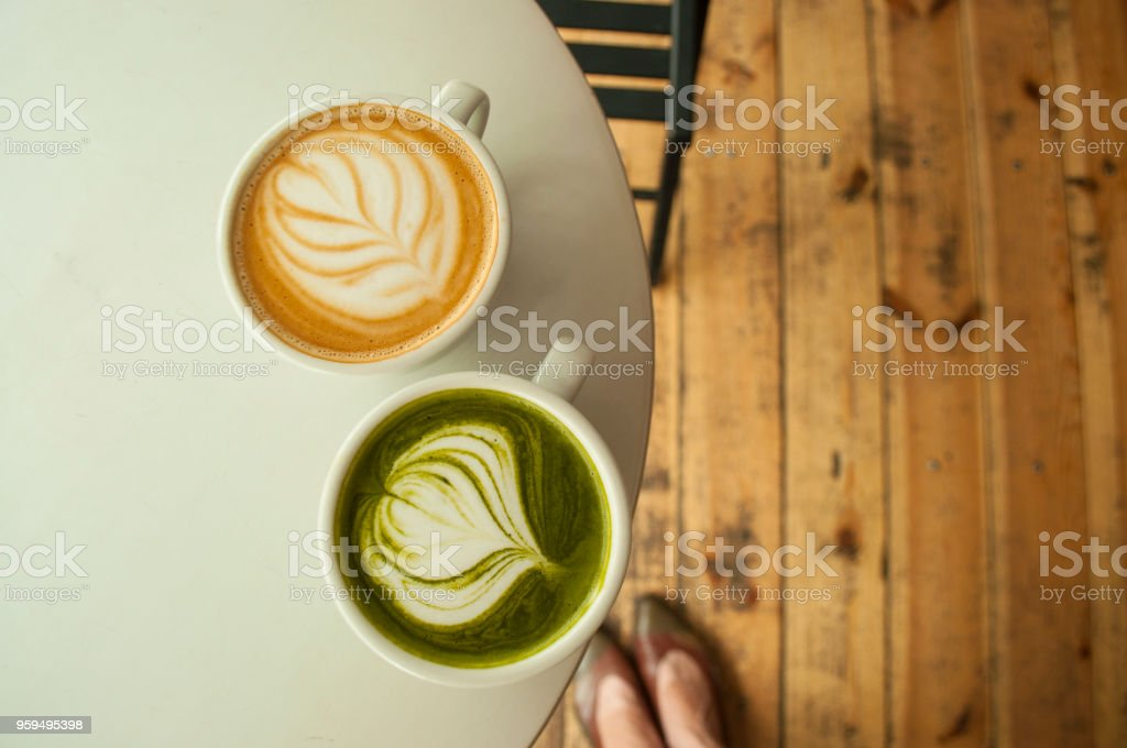 Top view of cup of matcha tea and cappuccino. stock photo