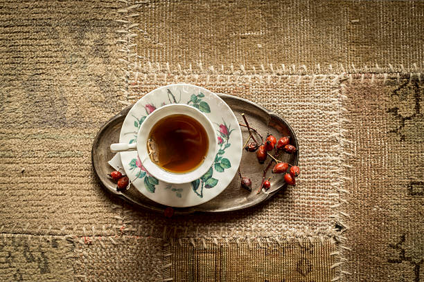 Top view of cup of tea on vintage carpet stock photo