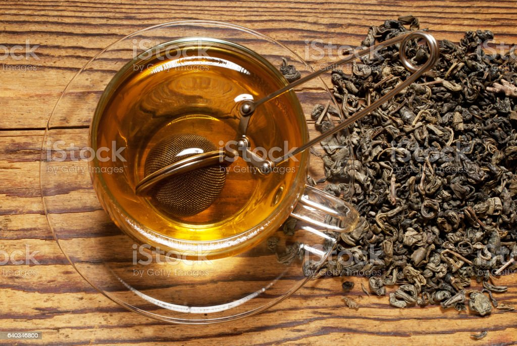 top view of cup of tea with strainer stock photo