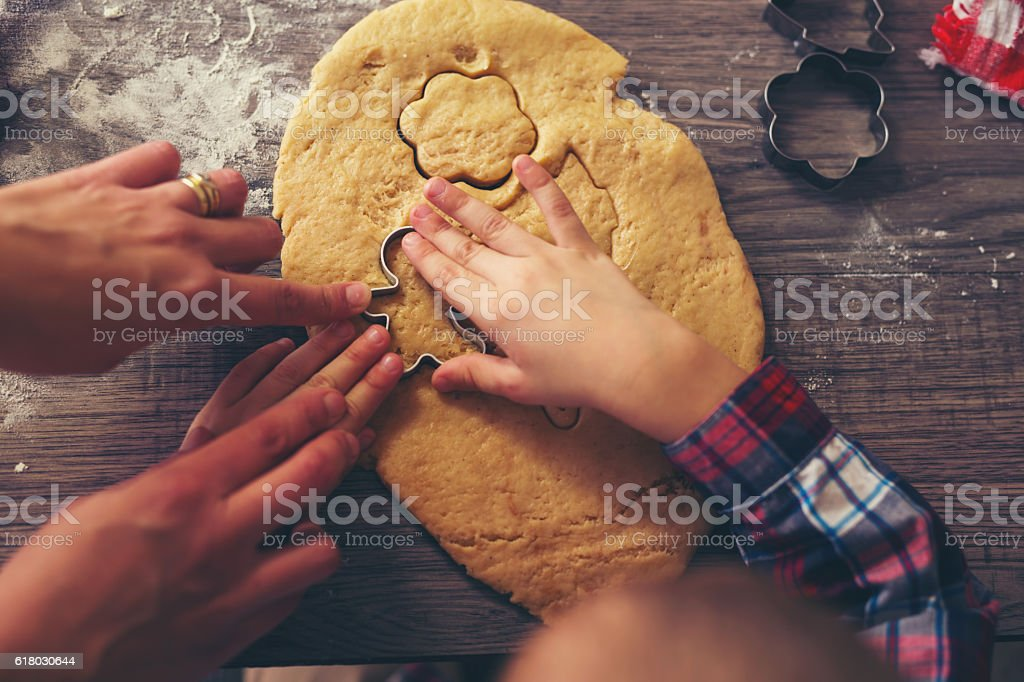 Top view of cutting gingerbread of metal molds stock photo