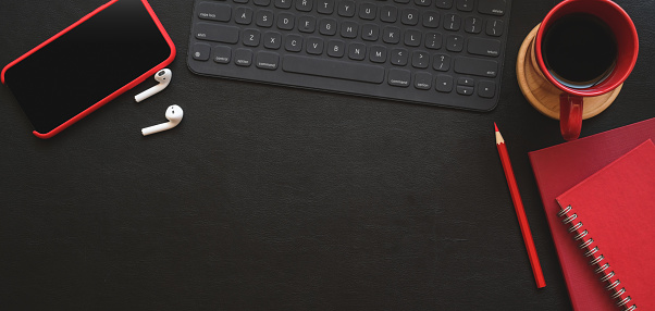 Top View Of Dark Modern Workplace With Red Office Supplies And Copy Space On Black Table Stock Photo - Download Image Now
