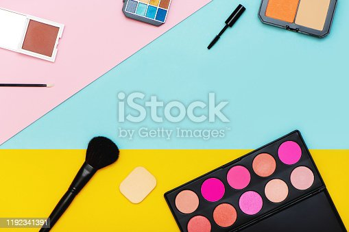Top view of decorative cosmetics on multicolor background. Flat lay.