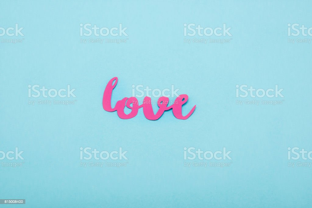 Top view of decorative pink love symbol isolated on blue background stock photo