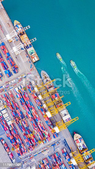 Top view of Deep water port with cargo ship and containers. It is an import and export cargo port where is a part of shipping dock and export products worldwide