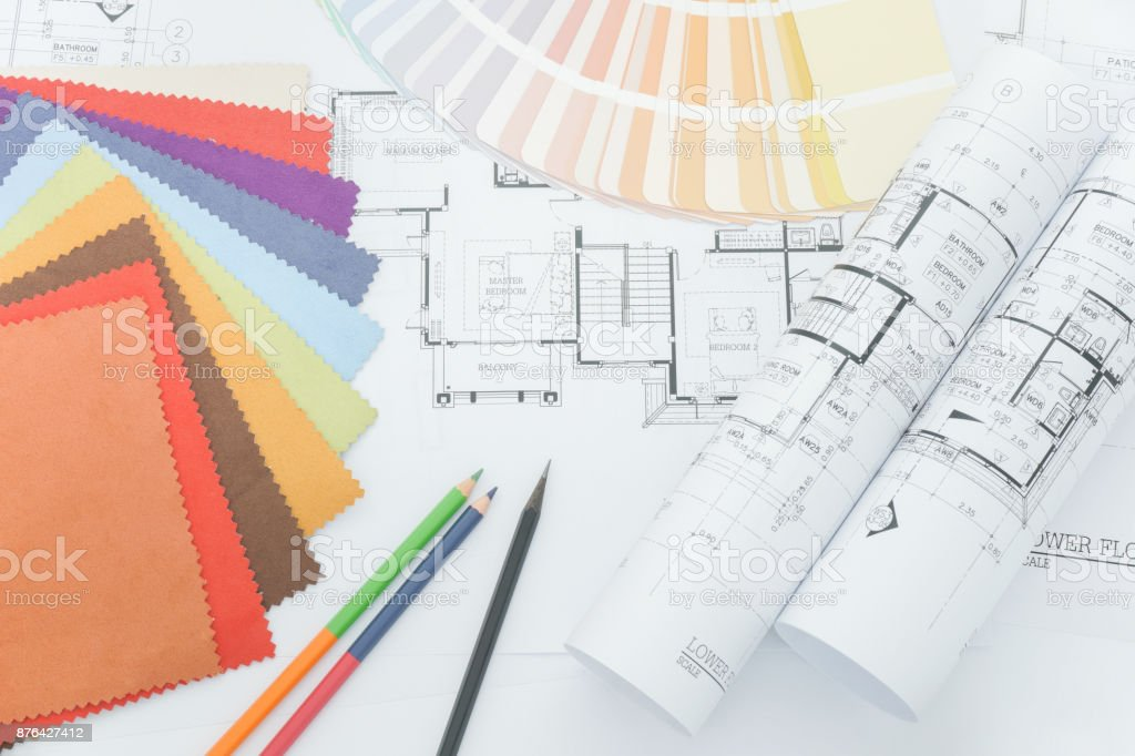 Top view of designer desk with sample of material and color pencil stock photo