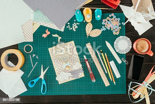 istock Top view of designer working place with scrapbooking postcard template 891303196