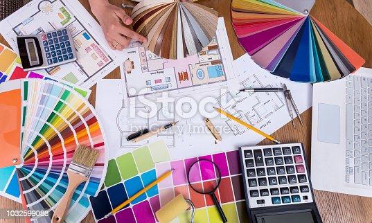 Top view of designers hands with wooden sampler
