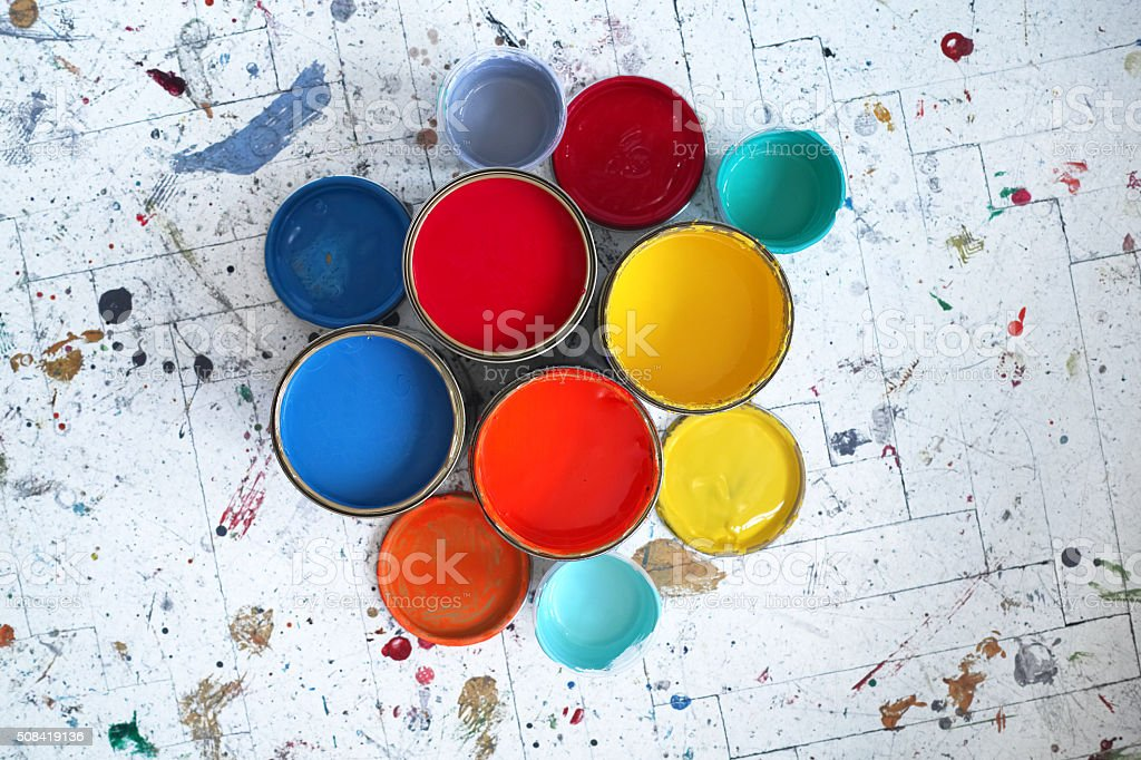 Top View Of Different Size And Colour Of Paint Tins stock photo