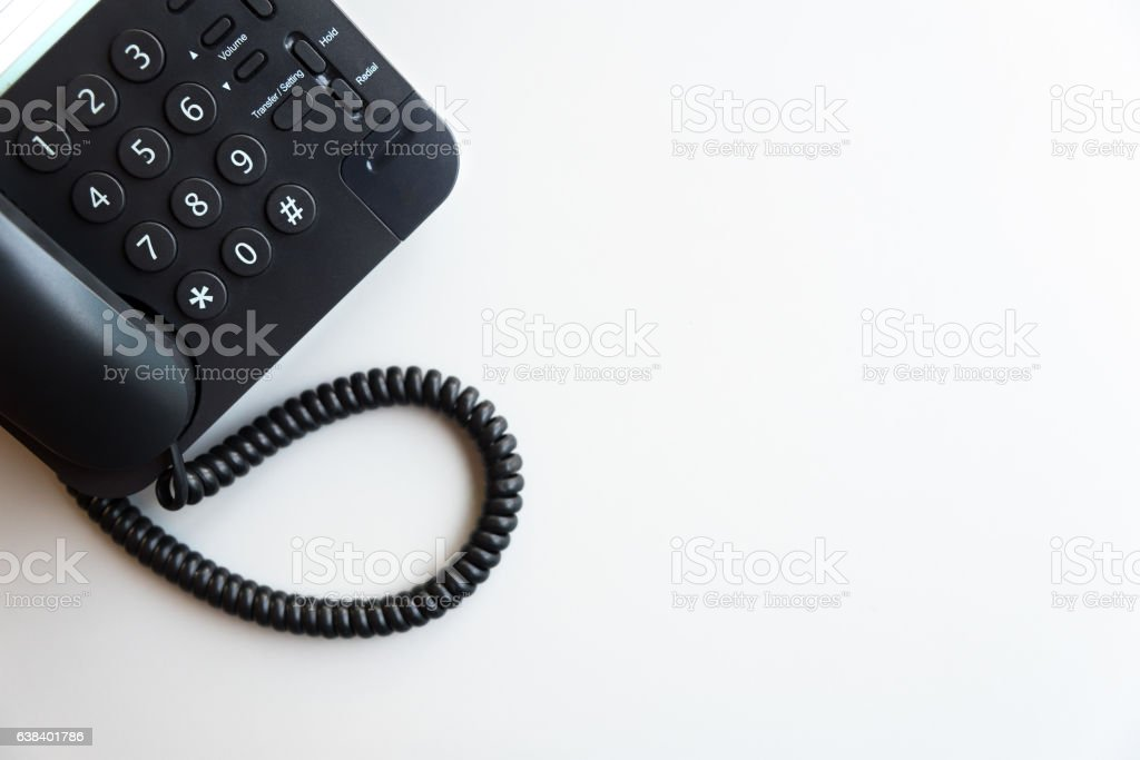 Top view of digital voip black telephone on white table stock photo