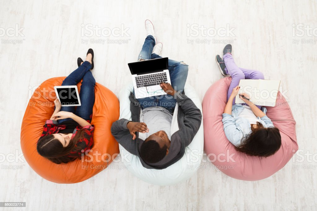 Top view of diverse people using smart gadgets stock photo