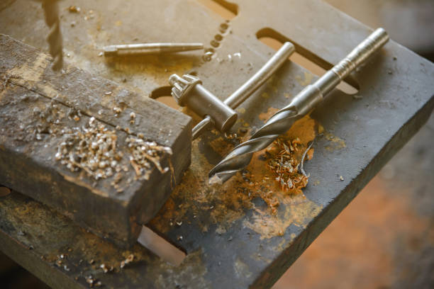 top view of  drill bit on drill press in industrial - pillar drill stock photos and pictures