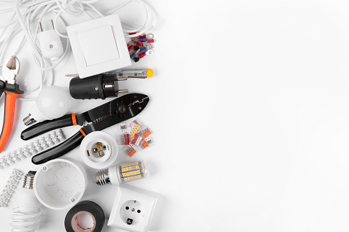 top view of electrical tools and equipment on white background