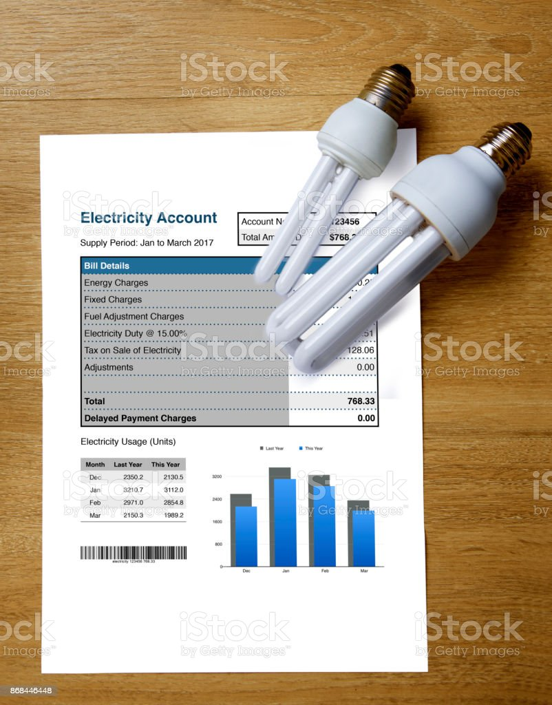 Top view of electricity account bill with two light bulbs. stock photo