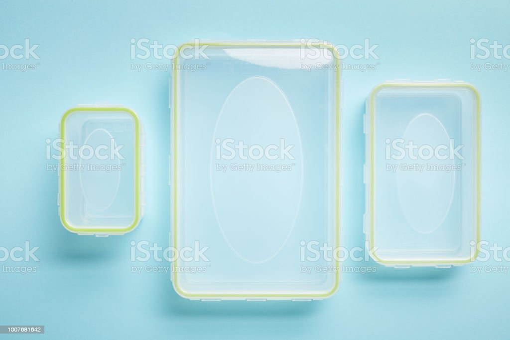 top view of empty food containers isolated on blue royalty-free stock photo