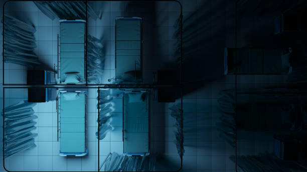 Top-Ansicht der leeren Krankenhausbetten, die von Blauem Licht im Dunkeln ohnmächtig beleuchtet werden – Foto