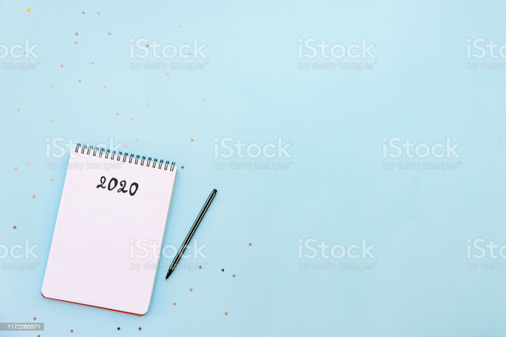 Top view of empty notebook ready for New 2020 Year planing or wish list Top view of empty notebook ready for New 2020 Year planning or wish list 2020 Stock Photo