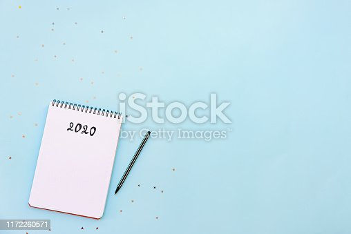 istock Top view of empty notebook ready for New 2020 Year planing or wish list 1172260571