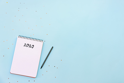 Top View Of Empty Notebook Ready For New 2020 Year Planing Or Wish List Stock Photo - Download Image Now