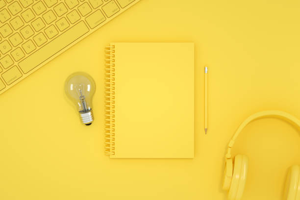 Top view of empty notebook with light bulb, new idea, brainstorming concept. - foto stock