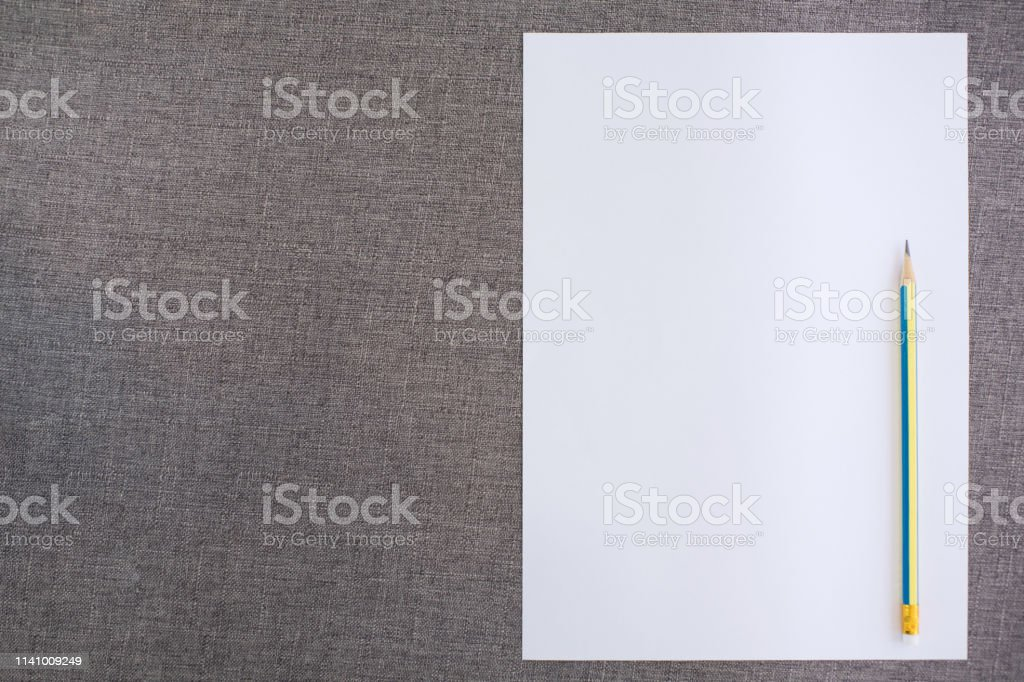 Top View Of Empty Paper With Pencil On Fabric Background Stock Photo